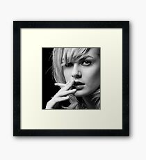 Portrait of Blonde woman smoking Framed Print