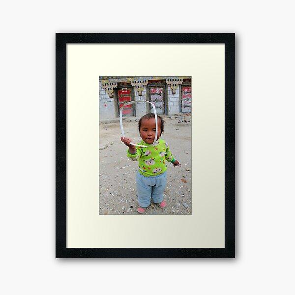 Tibetan girl Framed Art Print