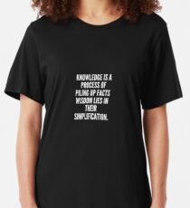 Knowledge is a process of piling up facts wisdom lies in their simplification Slim Fit T-Shirt