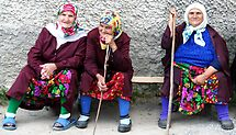 Pomac women in traditional dress by Bruno Beach