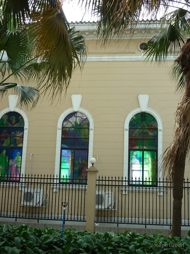 Colourful Ancient church windows shaded by exotic palm trees by Joseph Green