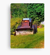 Old abandoned snow removing vehicle Canvas Print