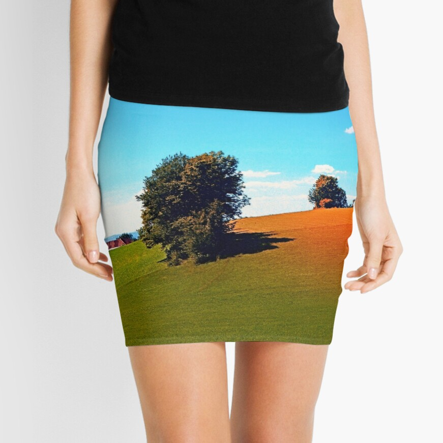 Trees, a hidden farm and fields of summer Mini Skirt