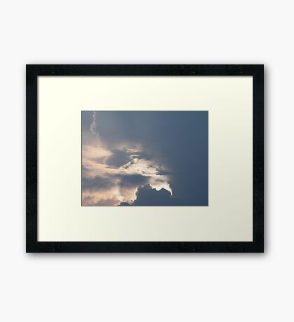 The Face in the Clouds Framed Print
