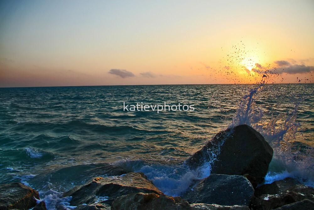 Waves crashing against rocks by katievphotos