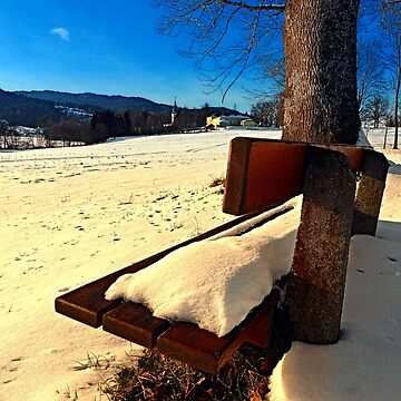 Snow covered bench in winter scenery | landscape photography by patrickjobst