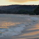 sun goes down on a beach by Alessandra Antonini