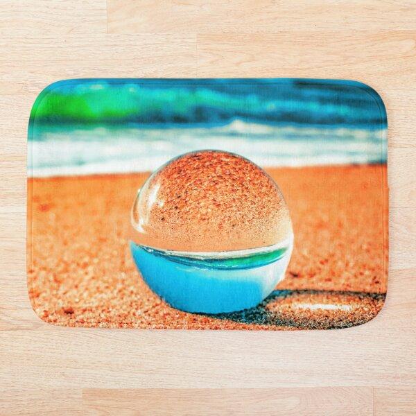 Lensball at the beach Bath Mat