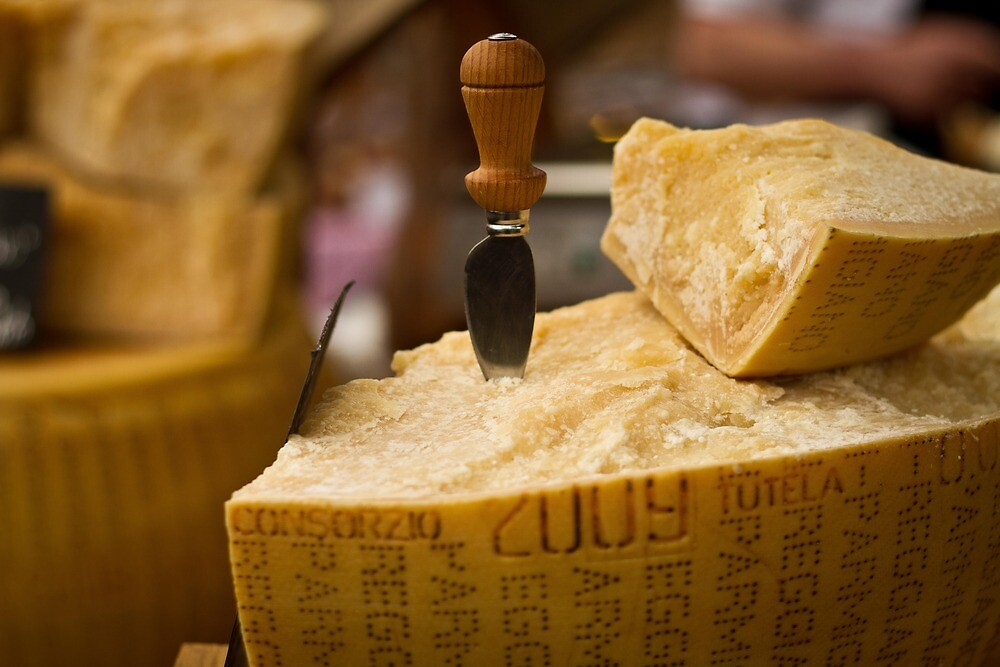 A slice of parmesan cheese by Justine Gordon