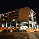Hotel Realm, Canberra (by night) by buildings
