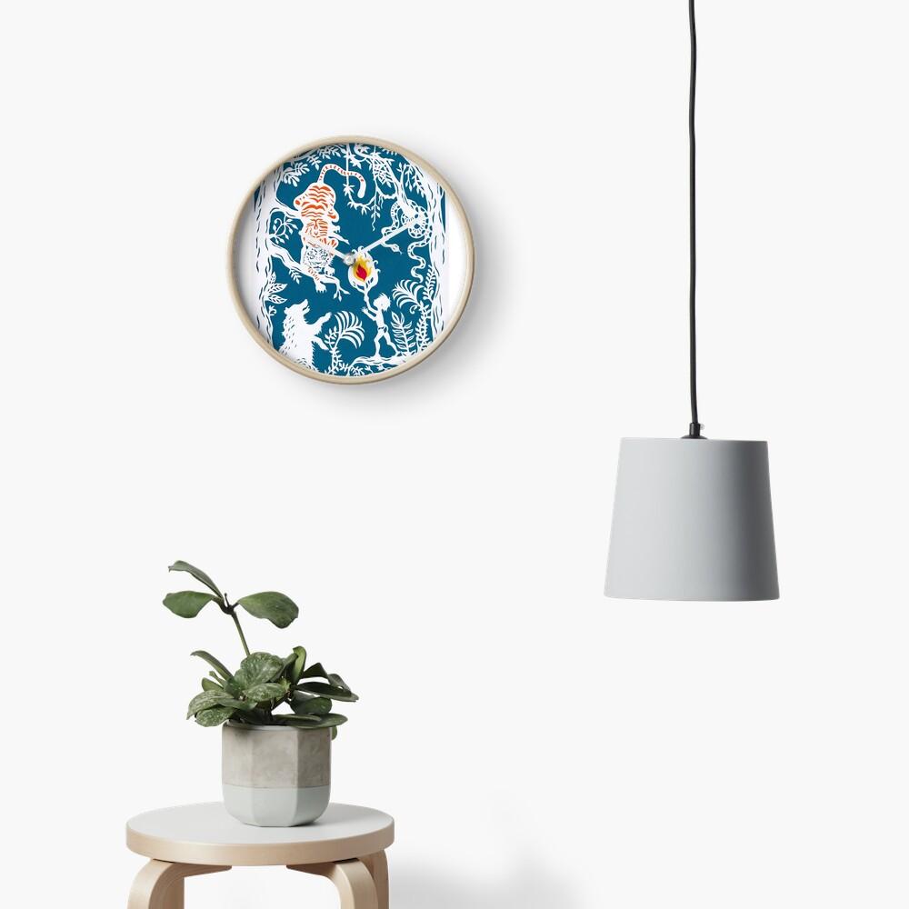 Mogli faces the Tiger ( Blue backdrop) Clock