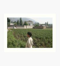 Pakistan- An Afghan boy  view the house of former al-Qaida leader Osama bin Laden Art Print