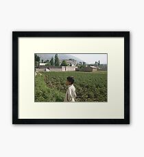 Pakistan- An Afghan boy  view the house of former al-Qaida leader Osama bin Laden Framed Print