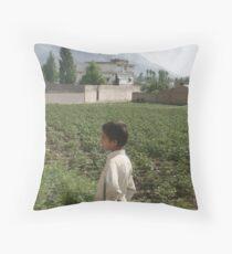 Pakistan- An Afghan boy  view the house of former al-Qaida leader Osama bin Laden Throw Pillow