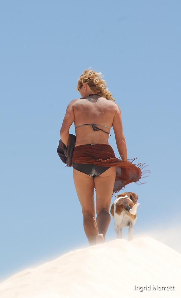 girl and dog on dune by Ingrid Merrett
